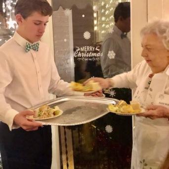 Volunteers serving savory plates